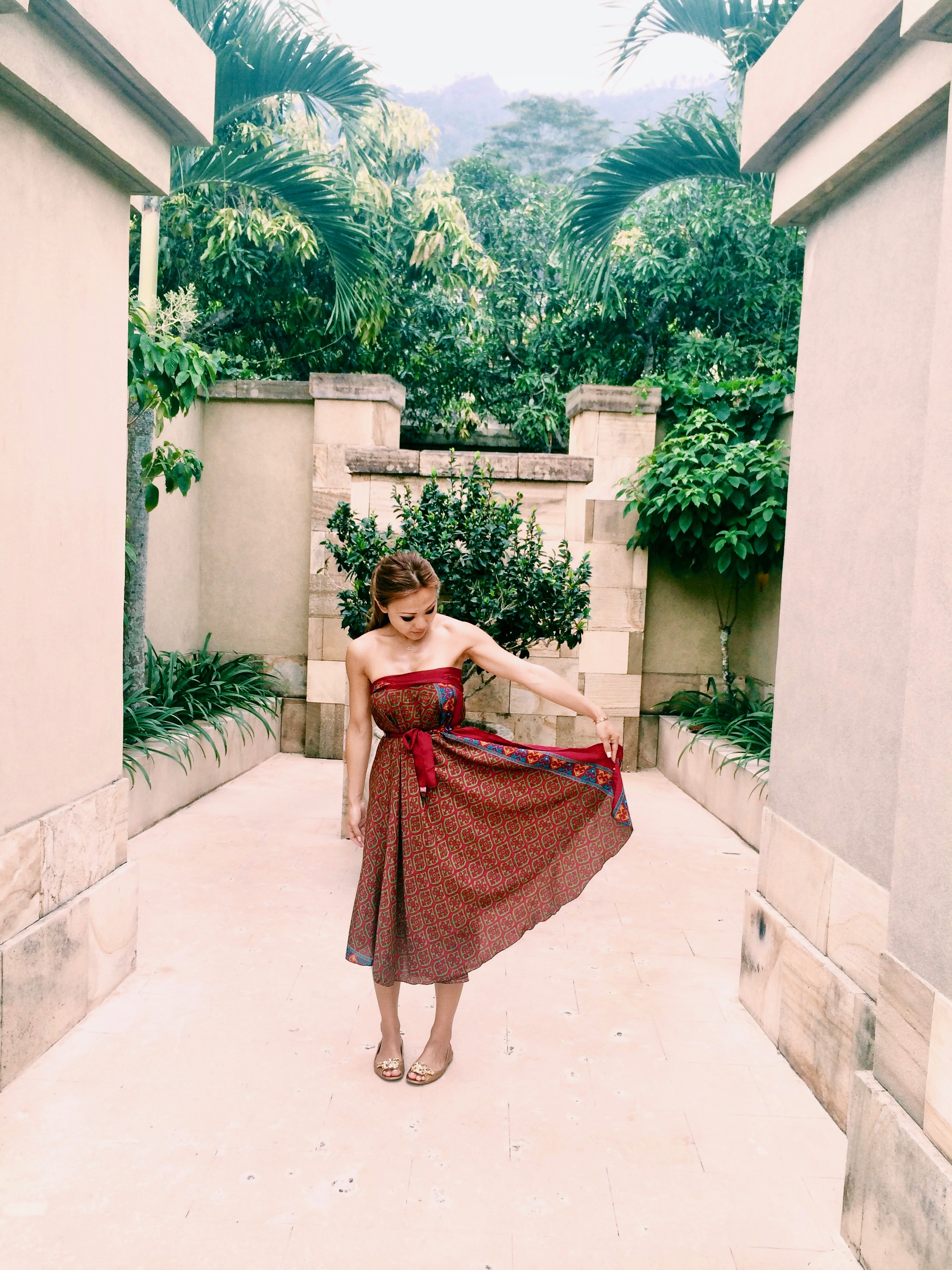 Our personal courtyard/walkway that leads to your bedroom and me sporting a balinese inspired silk wrap worn as a dress.