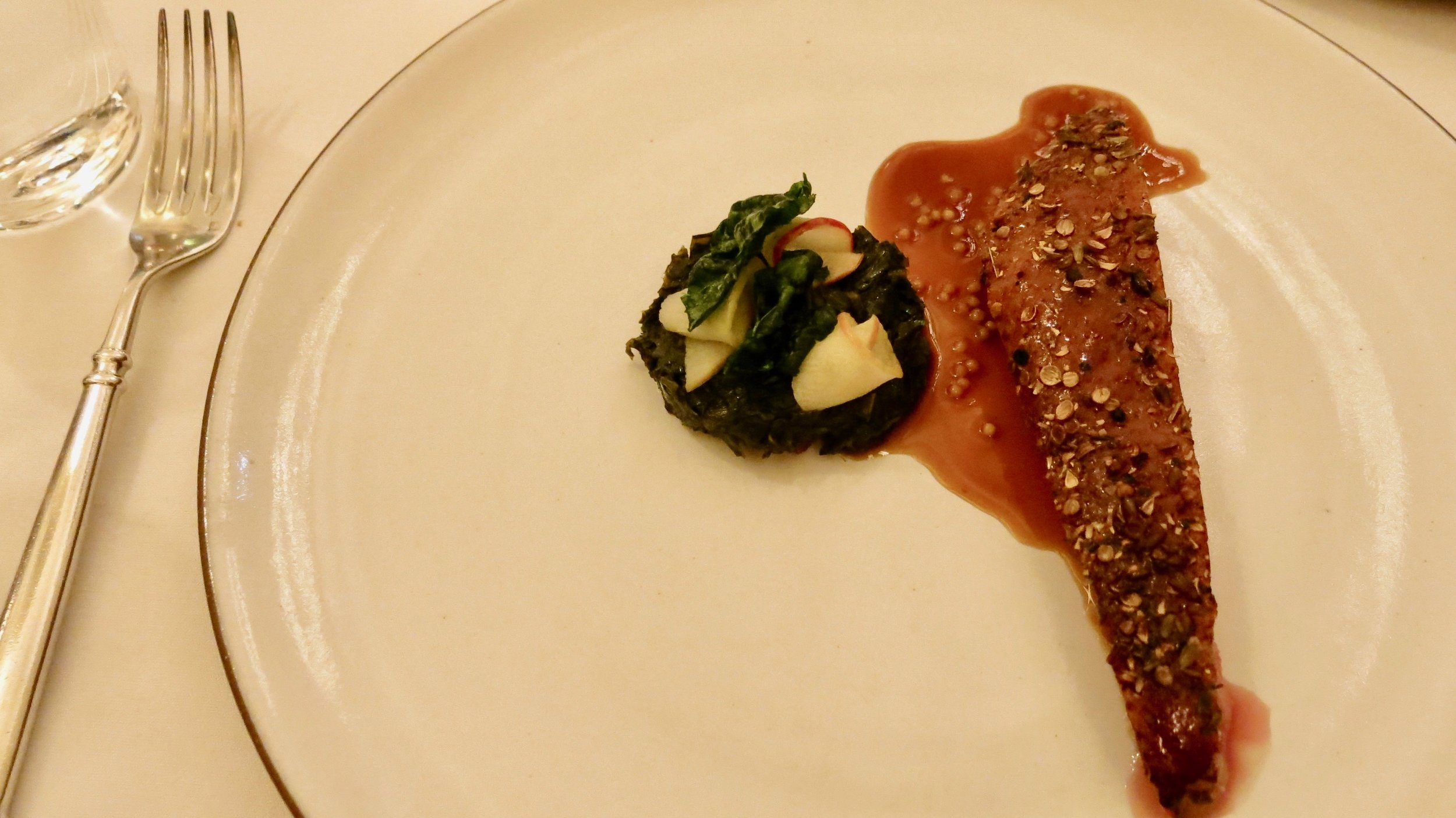 A beautiful sliver of Duck Breast along with collard greens and apple (Outstanding Dish)