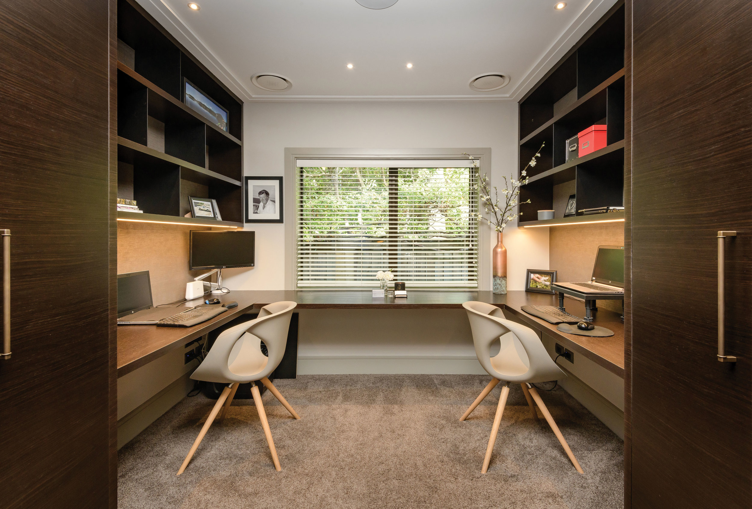 Office  A fifth bedroom has been converted into a his and hers office with built-in desk and storage manufactured and installed by Advanced Joinery. The office chairs are the Up chair by Tonon from David Shaw.