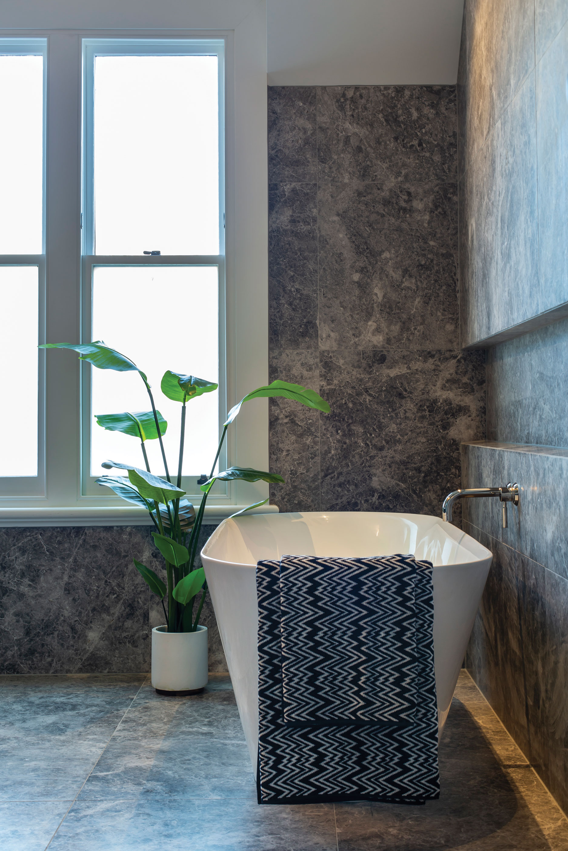 A luxurious addition to this peaceful space is the Sonit Clearstone freestanding bath from BathCo. The Missoni towels are from Corso Merivale.