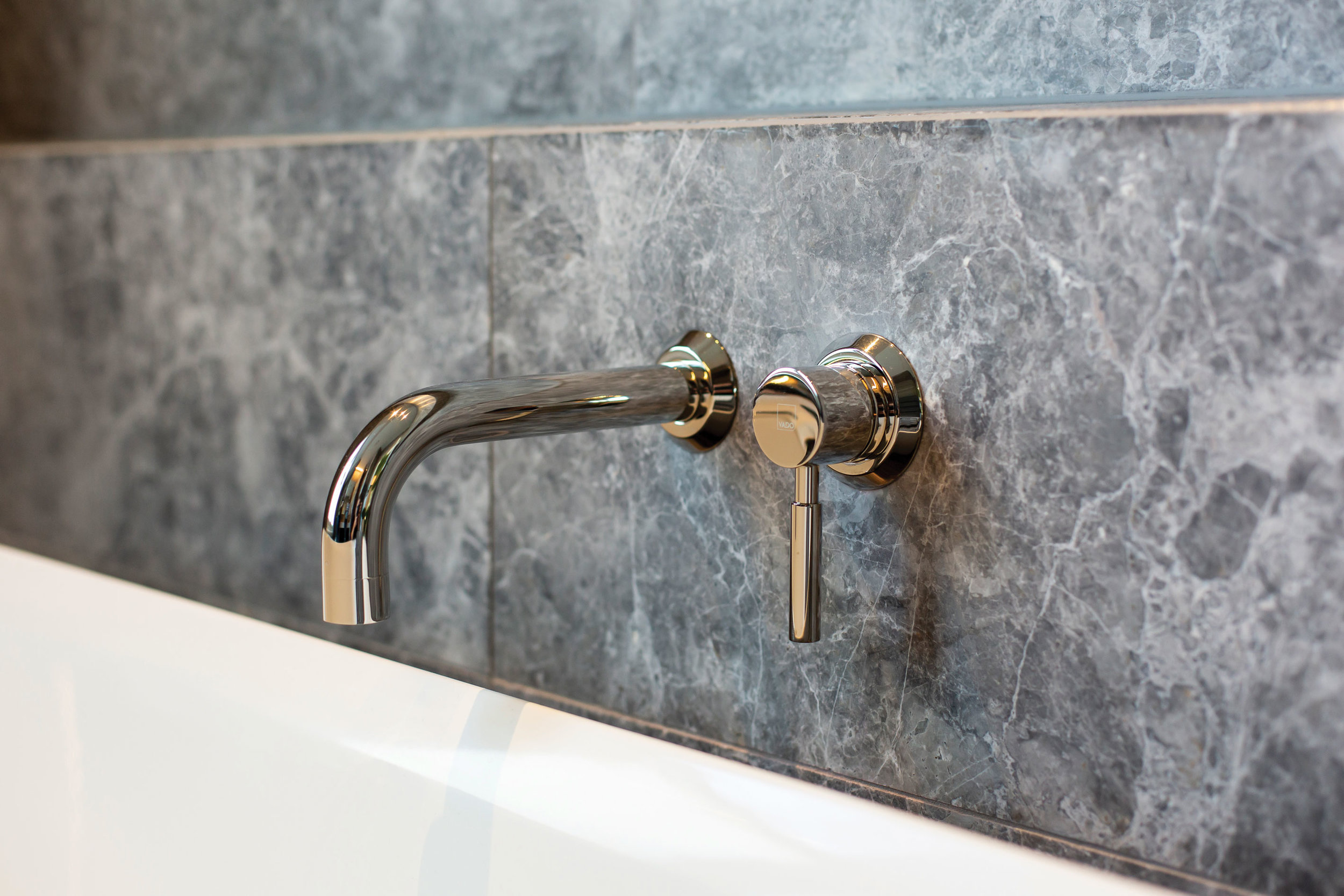 Tapware Working with the expert help of the team from Oakleys Plumbing Supplies, the owners chose stunning tapware from the Vado Origins range by Robertsons Bathware. The warmth of the brushed nickle finish beautifully accents the grey stone interior.
