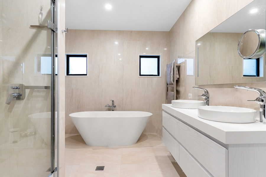 Master Suite:  The master bedroom is adjoined by a luxurious ensuite bathroom complete with twin basins and a freestanding bath.