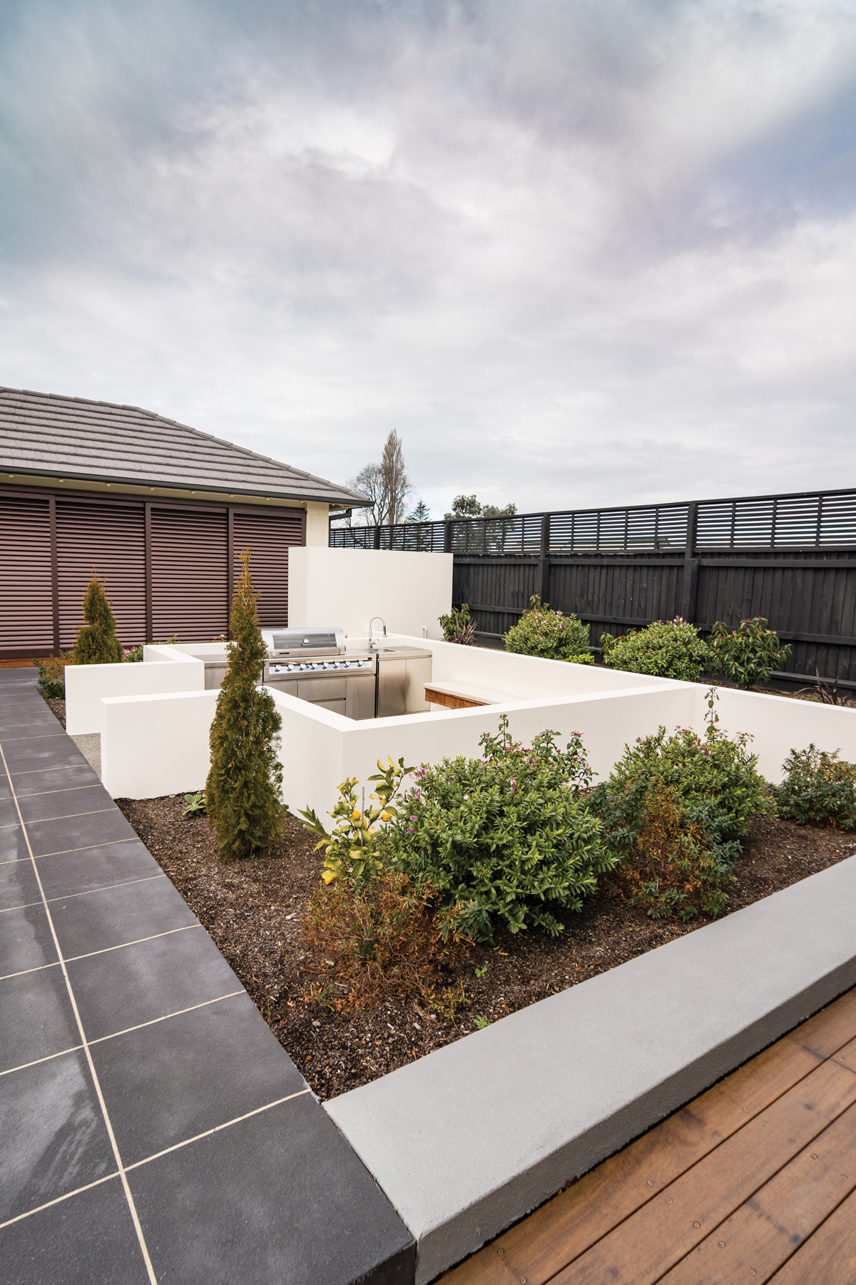 OUTDOOR SPACE:  Full of delightful features and creative uses of materials, this area has been beautifully landscaped by Styx Property Care, with input from Cornerstone Drainage, Affordable Concrete and Division Architectural Engineering.