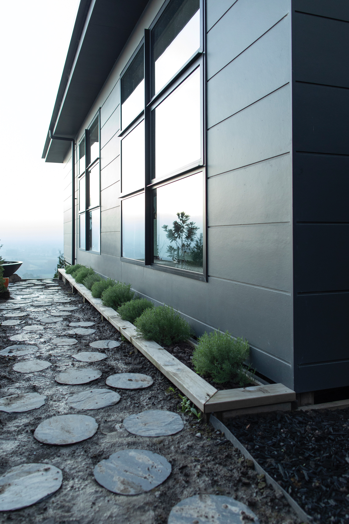 Exterior cladding:  James Hardie Stria cladding in light grey gives a timeless look to the exterior.