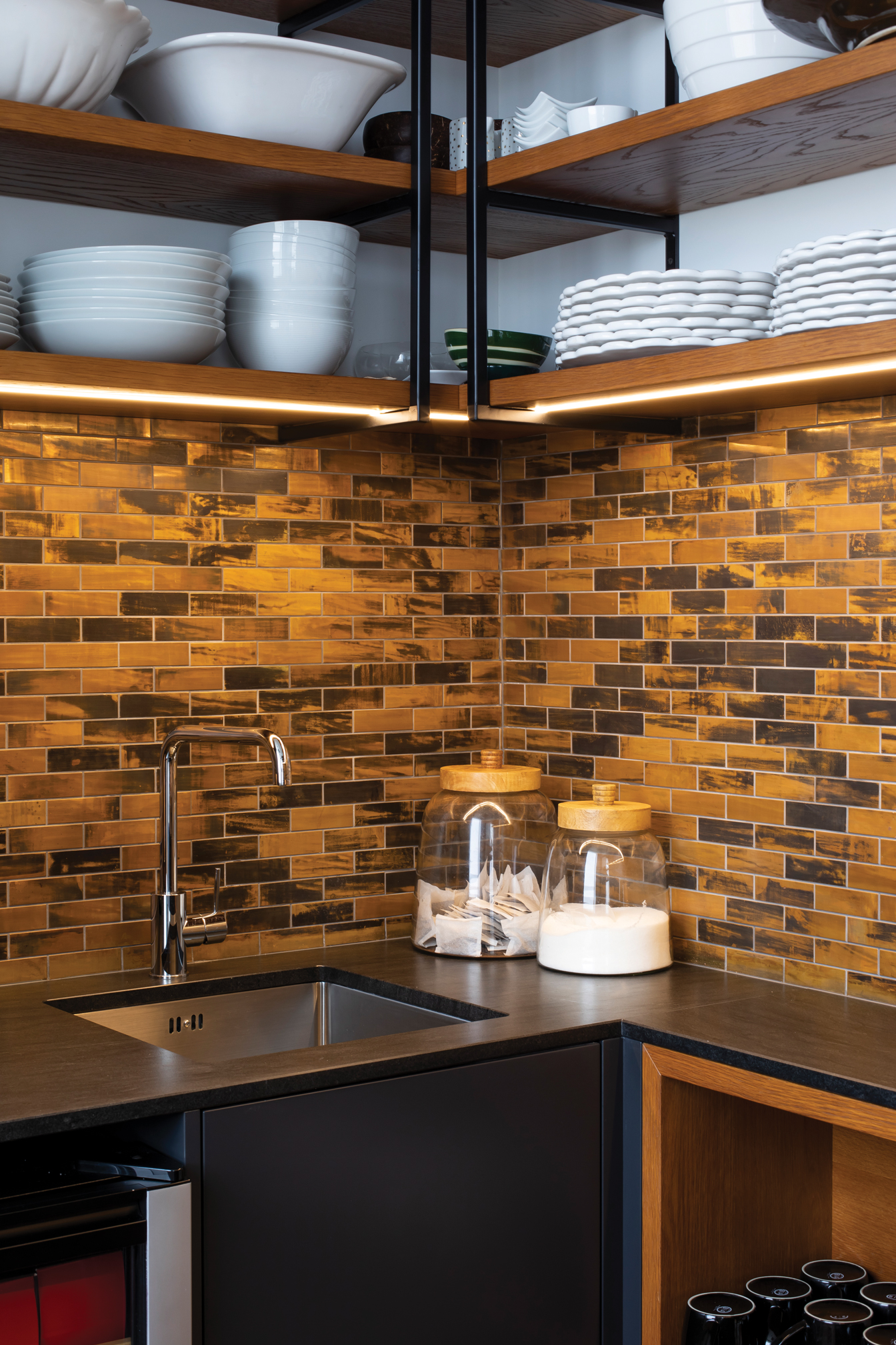 PANTRY: Copper Brick Bond mosaic tiles give a modern rustic look for this sleek pantry.