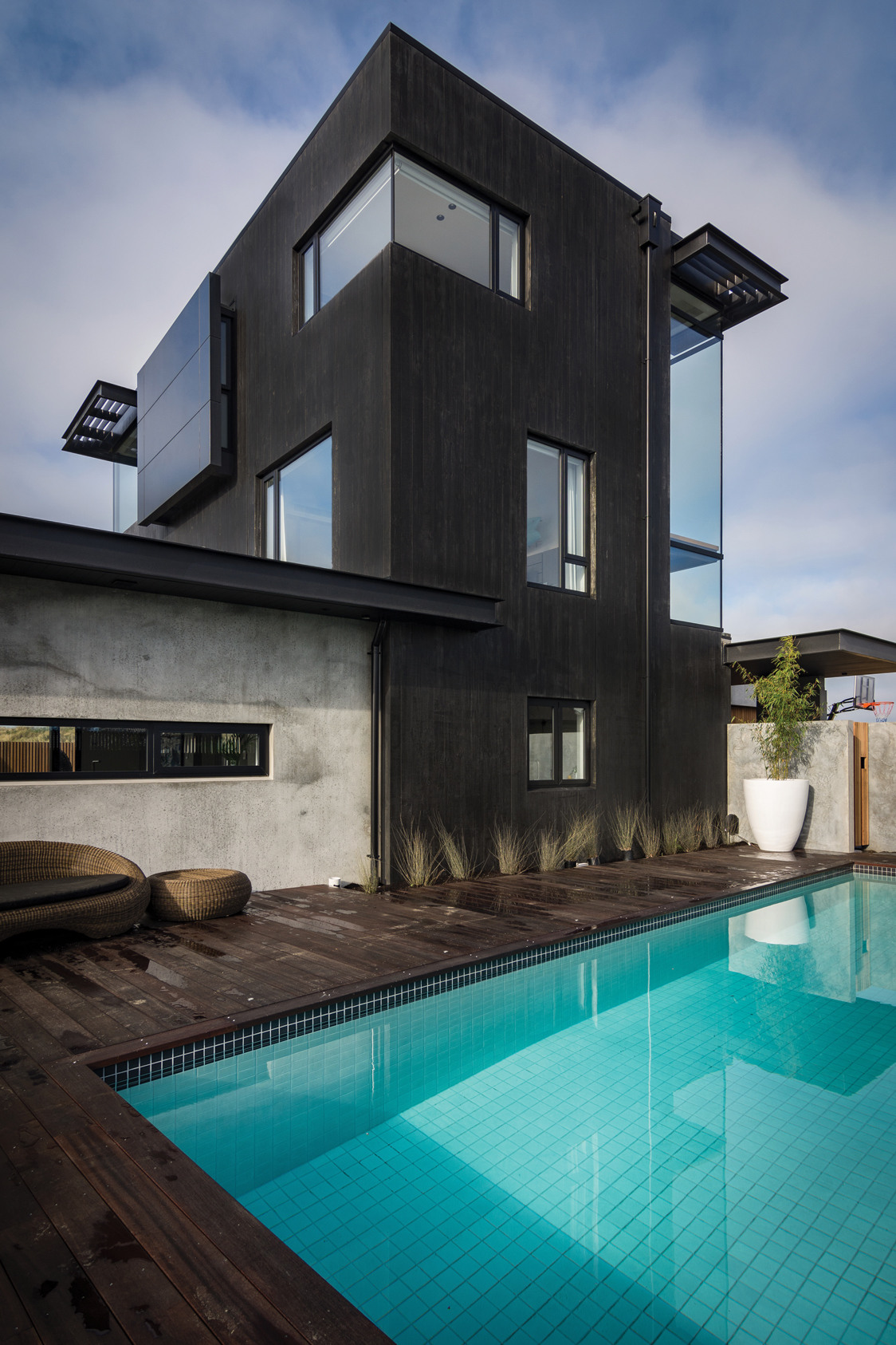 OUTDOOR FEATURES:  The inground swimming pool construction and tiling along with the hard landscaping were completed by Lanyon and Le Compte, experts in concrete construction.