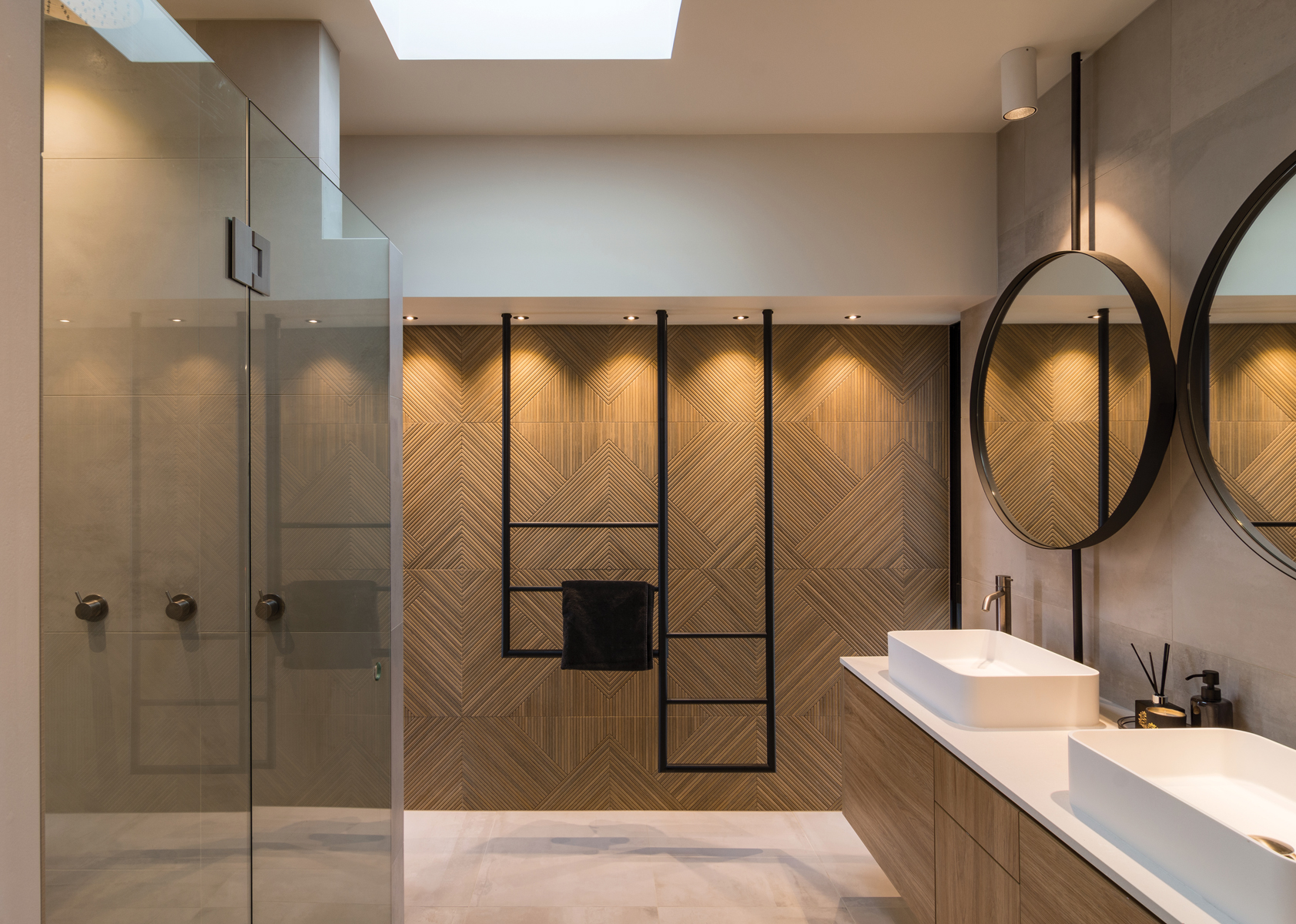 BATHROOM:  The ensuite bathroom features exquisite timber-look tiles to provide a connection with the timber used in the bedroom and wardrobe furniture.