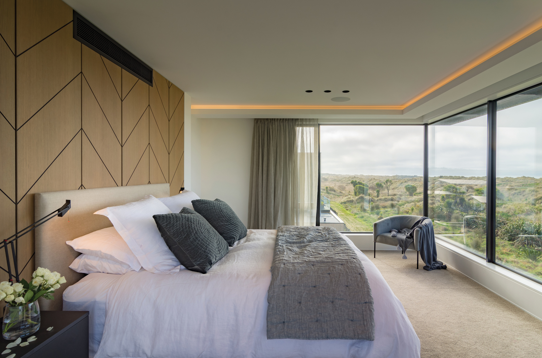 BEDROOM:  The master bedroom has custom recessed joinery headboard and floating wall-hung side tables in Baroque Wilderness and prime laminate in black velvet super matte.
