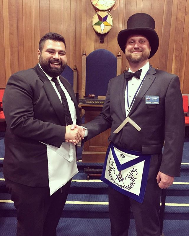 Junior Warden Michael Ramoneda (acting as Master of the Lodge) with newly-initiated Entered Apprentice Alaeddin Mistikoglu