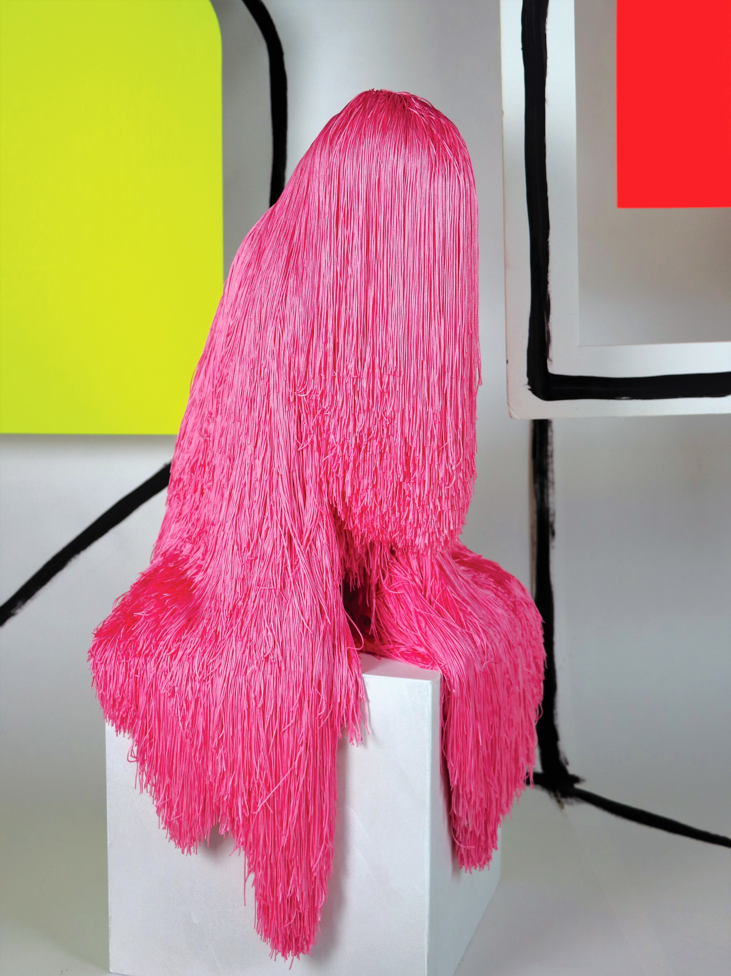 Troy Emery,  pink lump,  2018,  polyrethane ,  polyester tassels, glue, pins. Styling and Photography by Annette Wagner