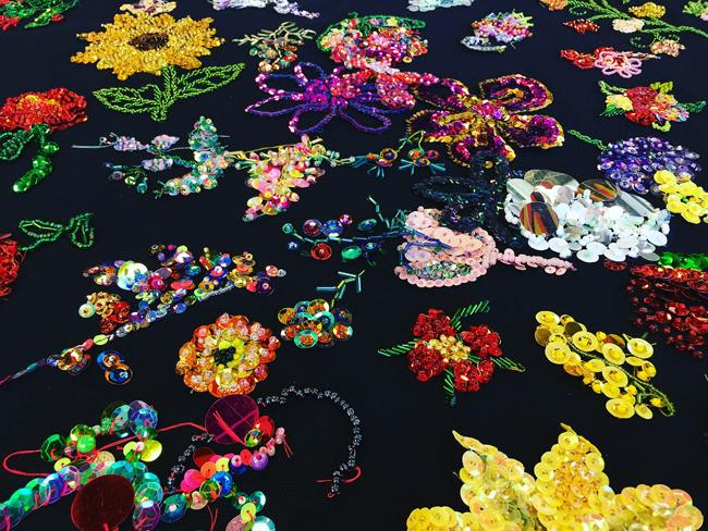 Participator community embroidery, Thoughts and Prayers - Facilitated by Liam Benson, 2015 – ongoing, glass seed and bugle beads, sequins, cotton, tulle, 135 x 135cm. Courtesy the artists and Artereal Gallery, Sydney. Photograph Liam Benson.