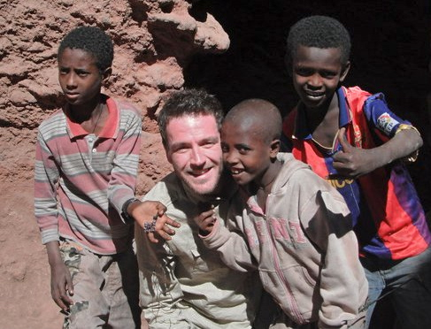 Ashley filming at the rock hewn churches in Lalibela, Africa. He made friends, quickly.