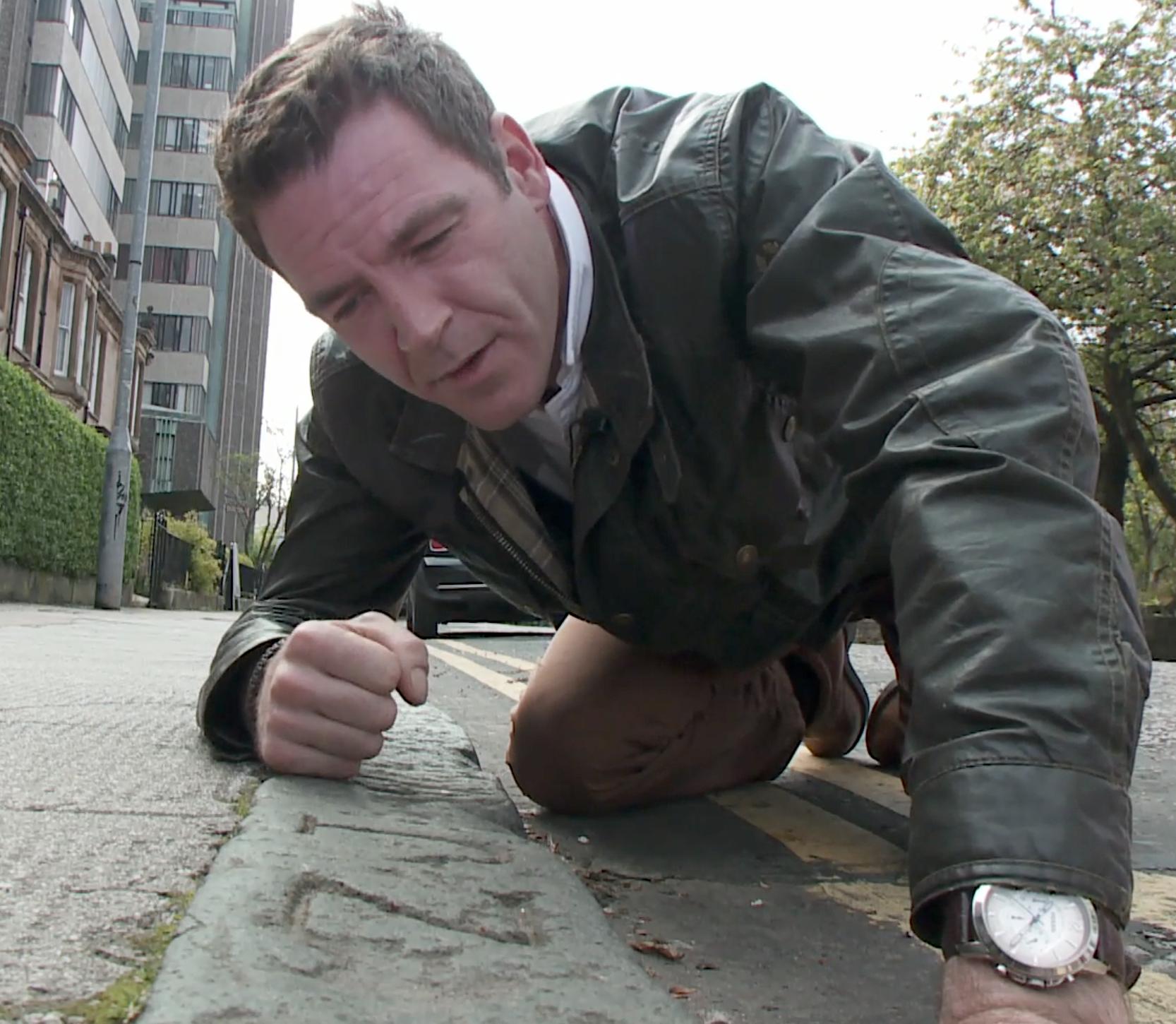 Ashley inspecting stonemasons marks on University Avenue in Glasgow's west end.