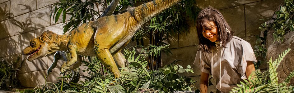 Exhibit at the Creation Museum, Petersburg, Kentucky showing dinosaurs and humans living together.