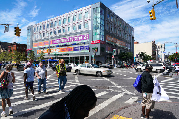 Whole Foods Market opened in Harlem in July. Its arrival is one of the changes that has longtime residents of the neighborhood concerned about gentrification.  Image:  CHANG W. LEE / THE NEW YORK TIMES
