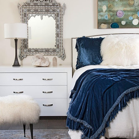 Luxe Looks - Give your bedroom a quick style update and prepare it for the season by layering in textured bedding, throws, and pillows. Winter room decor—like this luxurious velvet throw and soft faux fur bed pillows—turn a bedroom into a cozy refuge from harsh winter winds.