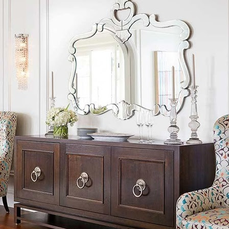 Reflective State - With the shorter days, it's time to maximize what natural light is still available. Hanging a large mirror on a blank stretch of wall or above a mantel display will reflect light throughout your space. Turn the mirror into a decorative display by painting the frame an eye-catching color, or opt for the simplicity of winter white decor.