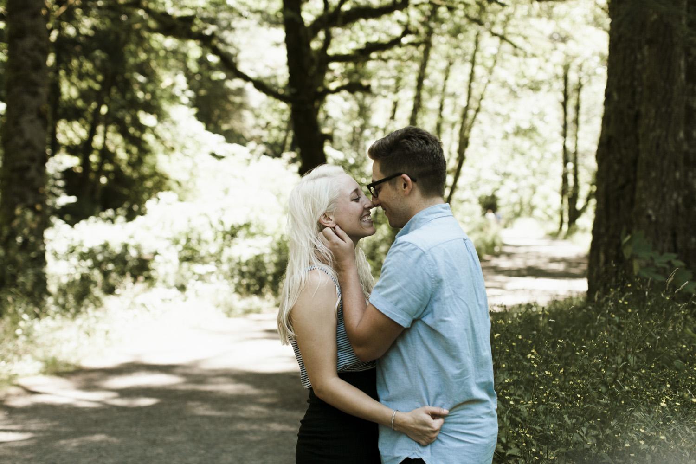 columbia-river-gorge-wahclella-falls-engagement-photos-push-hair-back