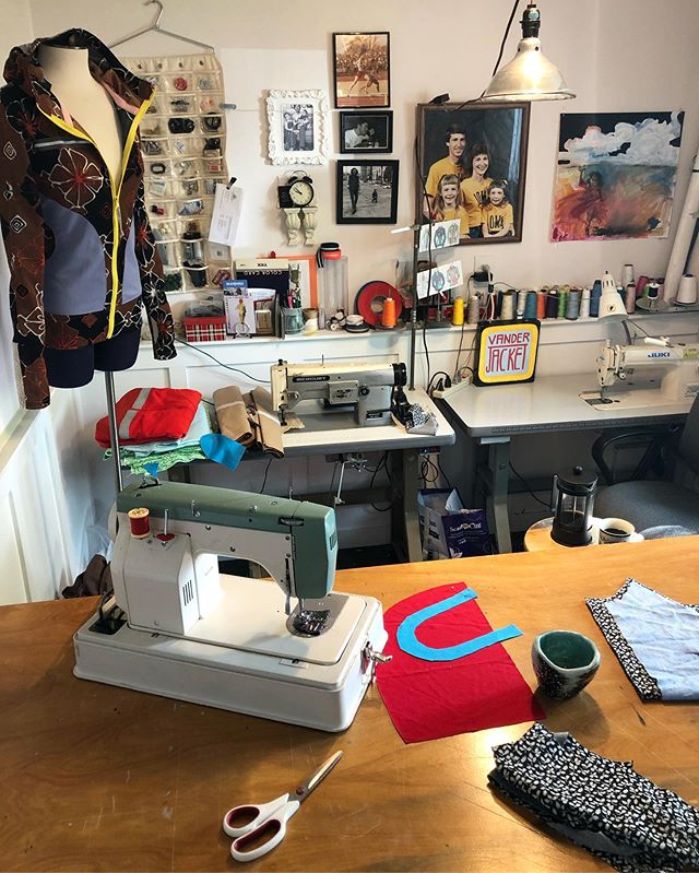 #WHEREIWORK Here is a little snap of the Vander Jacket studio—it reveals so much about the company as a whole. - - BEVERLY THE DRESS FORM: She's my fit model. I know that if the jacket actually fits Bev, no one in the world can ever wear it; God doesn't make humans like Bev. - - CLOCK: It's a time warp down here in my basement studio. I need several reality checks. ⏰ !!!! - - MACHINES: Yeah, I've got a few of those...and more in the garage. The mean green one is my original Vander Jacket machine. I sewed my first 500 original running jackets on her before buying my Juki industrial straight stitch. Notice: I don't do sergers. Personal preference. - -  EXTRA LARGE FAMILY PHOTO: A tribute to my parents, the most encouraging people in my life. The story goes that Sears had a special, offering one free enormous family portrait print, with the hope that parents would then buy additional photos, of course. This business plan was a sure fire way to bring in the proud domestic populous and their patronage. Sears didn't count on my parents, however, who had no problem posing for a free portrait Maximus, and then walking away with the billboard—and nothing else— completely guilt free. I'm not sure why we are wearing Iowa shirts. 🤔 I had to steal this gem from my people, and I still bear a reputation as being the family kleptomaniac. - - INTANGIBLES: These are the details that don't Instagram well: the thread clippings dripping from every protruding object, the faint smell of metal and paint, the colors of every fabric scrap and every spool. The faint elements in my studio are what makes me love to be in it. The best part is the window: glimpsing my daughters ride by on bikes and my husband coming up the walk. And the sound of machines humming. I like it here! I'm building my business here. 🙂 @howibuiltthis - - #vanderjacket #geargarment #inthestudio #designstudio #designinspo #coloradomade #madeincolorado #coloradolove #denvermakers #5280magazine #5280life #responsiblymade #responsiblysourced #ethicaldesign #ethicalfashion #bosslady #smallbusinesslife #madetolast #outerwear #outdoorgear #sustainableclothing #sustainablymade #responsiblymade #denverlocal