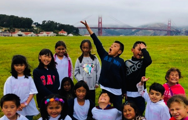 Longfellow students are all smiles at Crissy Field during a summer field trip day