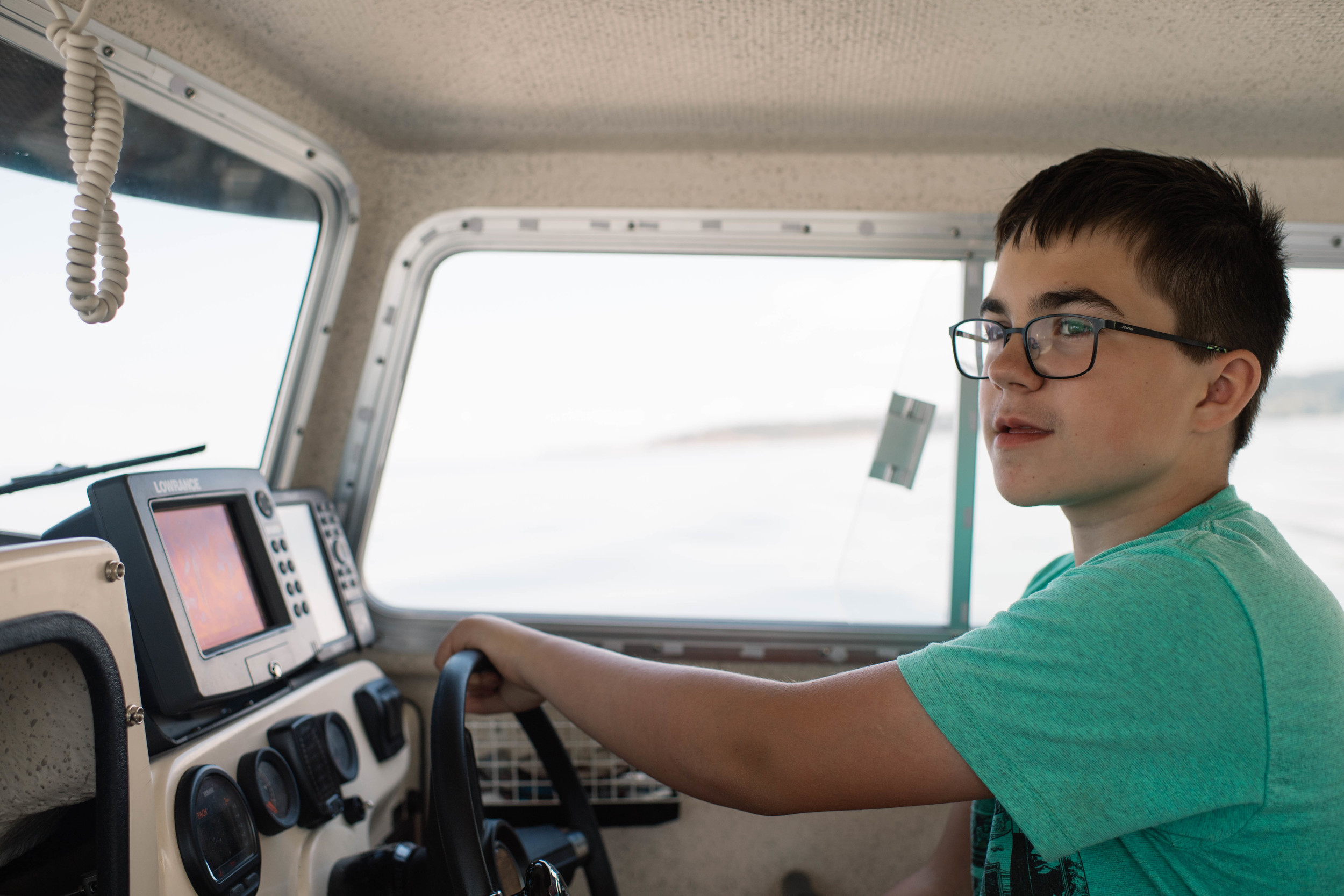 Kole has become quite the boat captain!