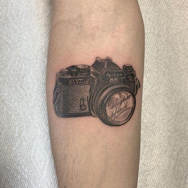 Nikon for @higherhand done at #bodyelectrictattoo . . . #tattoo #tattooing #la #losangeles #losangelestattoo #latattoo #melrose #rayjtattoo #smalltattoos #stippling #fineline #realism #nikon
