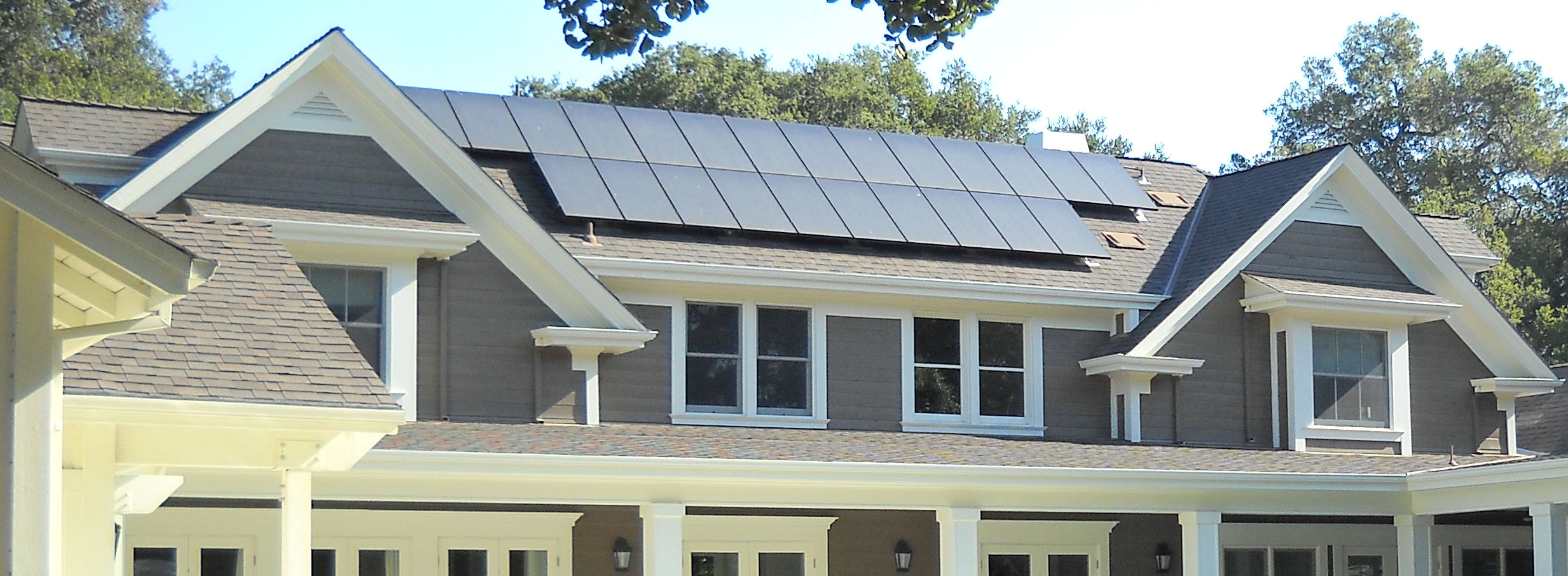 Solar panels on this   modern farm house   help to heat water throughout the home and pool.