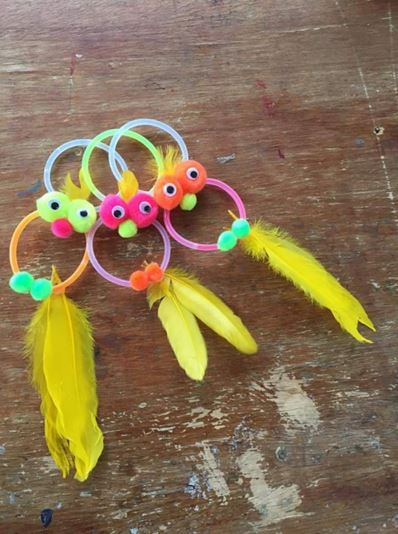 And these super creative birds made out of glow sticks, feathers, googly eyes and pom poms!