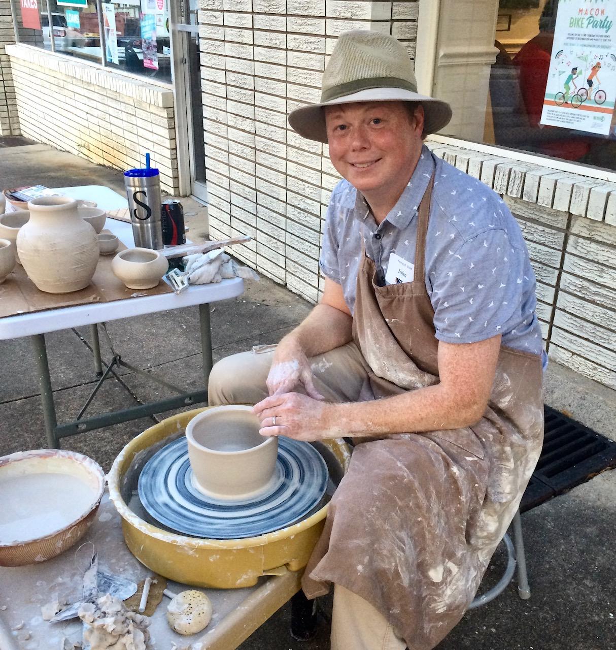 John Skelton gives a pottery wheel demonstration outside The 567.