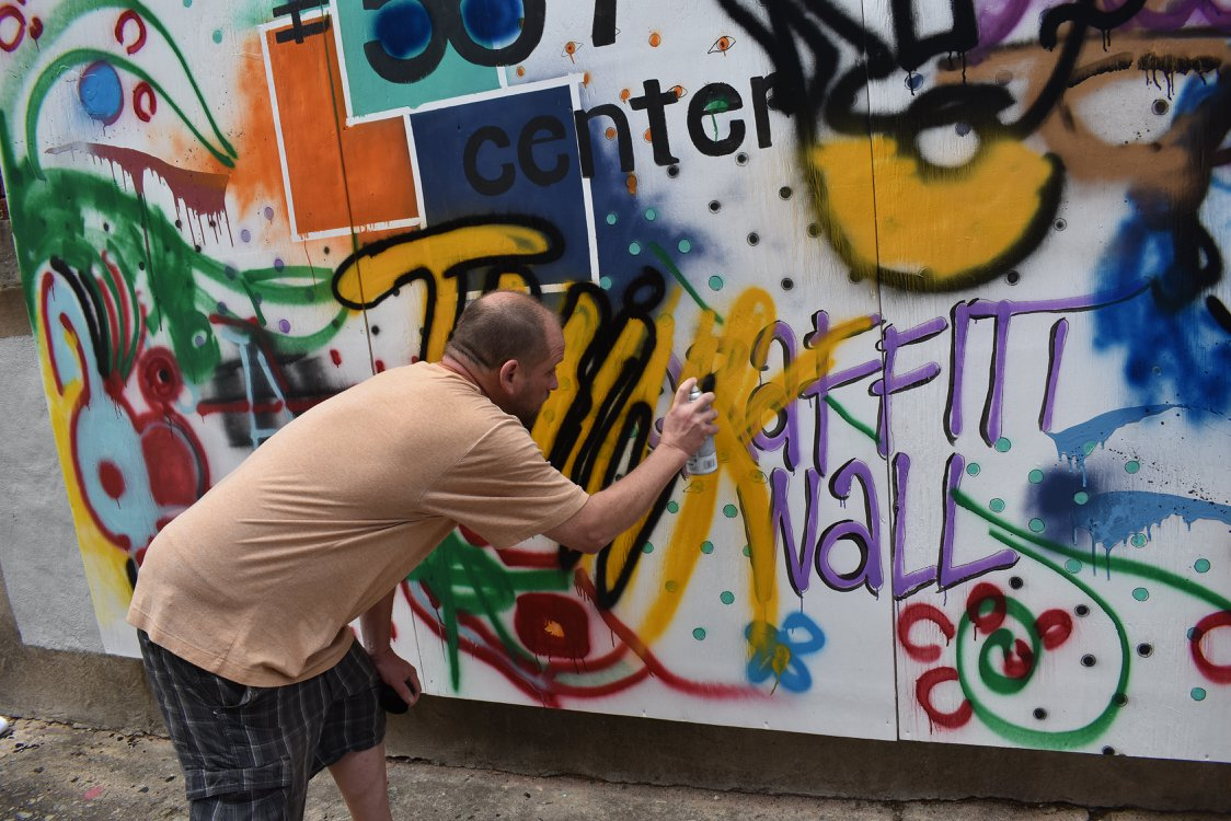 Artist paints on first Graffiti Wall in downtown Macon