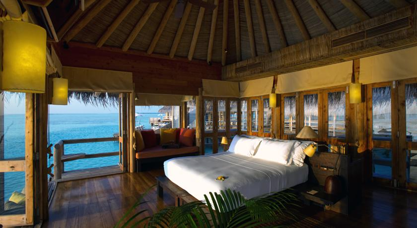 """Little amenities like a """"pillow menu"""" and """"happy honeymoon"""" welcome treats took this bedroom area over the top"""