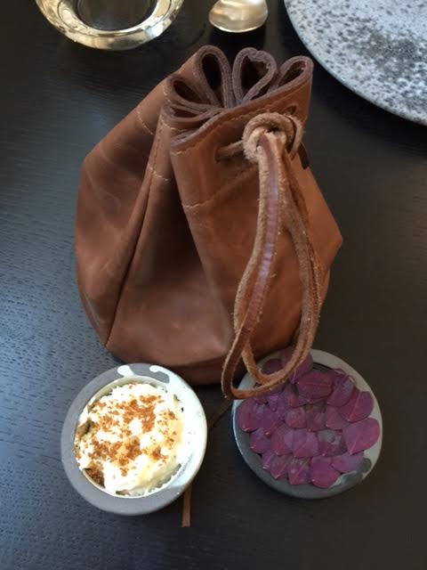 The bread arrived back to our table warm and in this leather pouch with chicken liver pate and pate