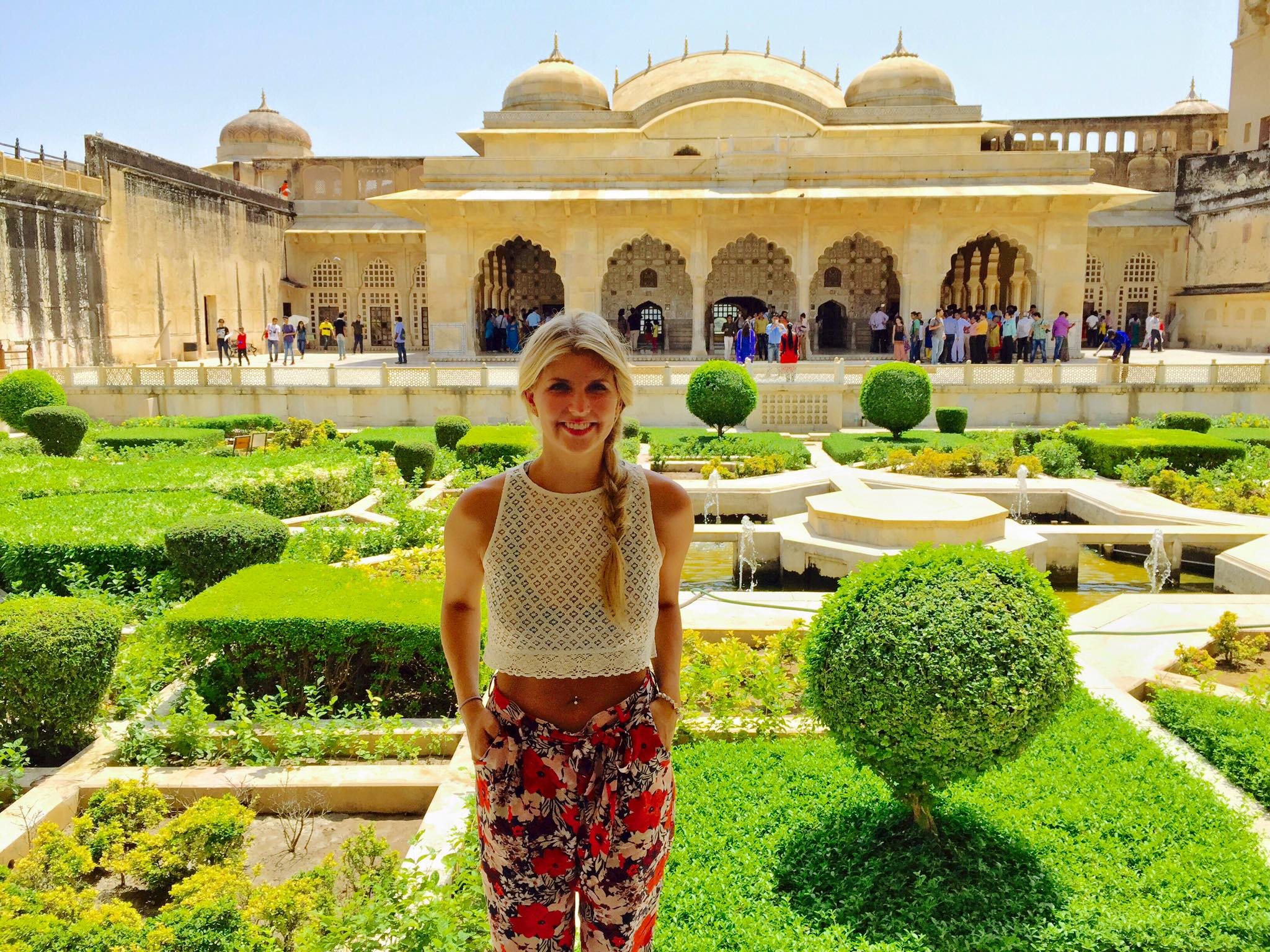 Ali ba ba pants and a crop top while sightseeing during the day at the City Palace