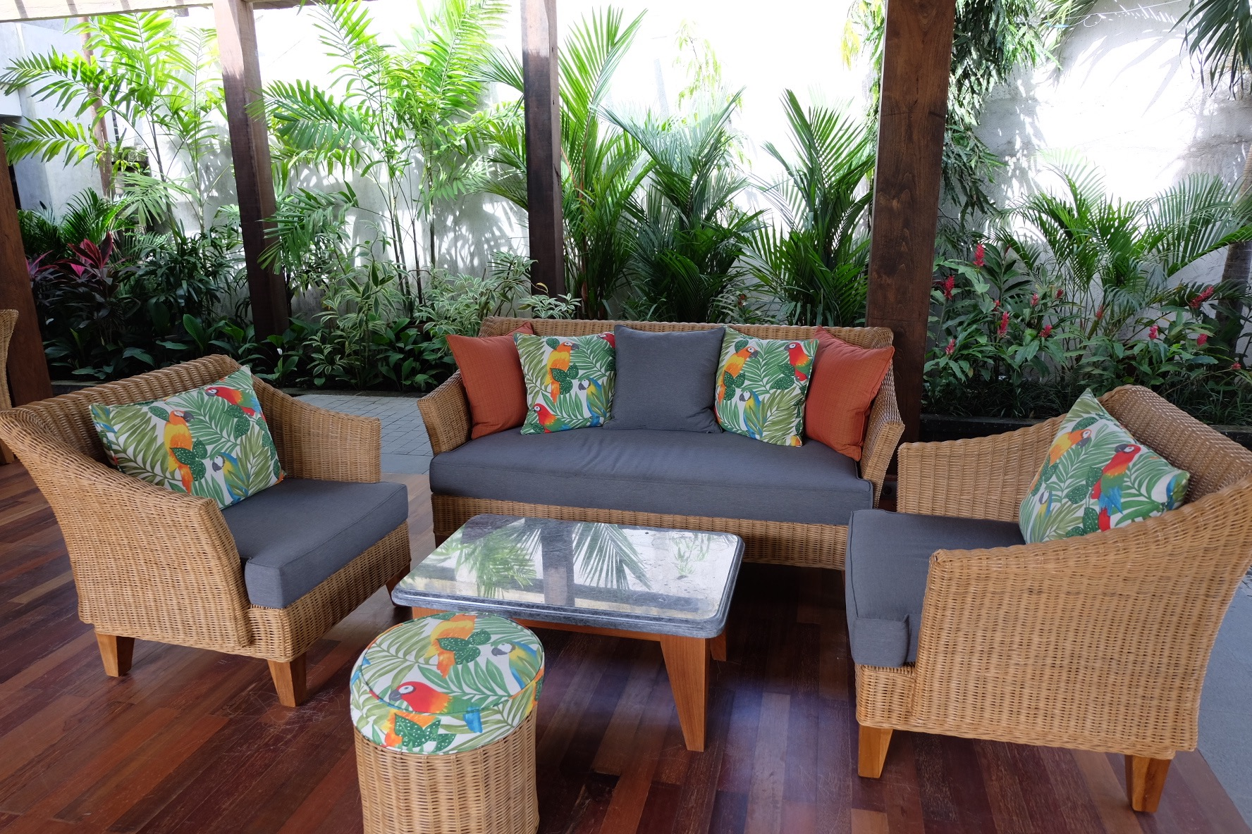 The open-air lobby area of the Alaya has lovely couches where you'll be served a welcome drink