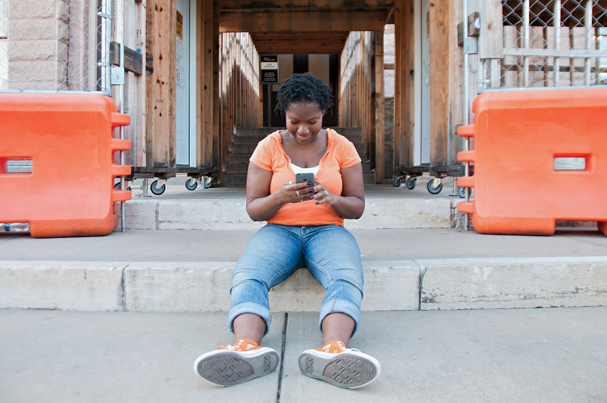 """Chalanna is an Americorps member who takes the train to work because it's an easier commute than driving. She sometimes catches Pokemon Go characters on her commute. Her photo was taken at the Capitol.    """"I grew up playing games. My dad would show us how to do all that stuff. I'm kind of a competitive person, so it's good to be able have that level of competition that doesn't mean I have to ruin all my friendships. Because I'm pretty intense. I really want to win."""""""