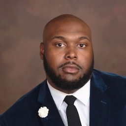 Elerod Morris II is a 2012 graduate of Winston Salem State University. He is currently employed as an Information Technology teacher at Carver High School and Instructor at Forsyth Technical Community College. He has been married for two years to Aiesha Morris and is the father of 2-year- old Elerod III and newborn Levinson. Mr. Morris is a member of Omega Psi Phi Fraternity, Inc. and Prince Hall Affiliate.  Mr. Morris has committed to the service of his community and provided opportunities for the  less fortunate with the goal of career development and advancement. Bee Geek, Inc. is the nonprofit  organization founded by Mr. Morris with the mission to serve the at-risk community by teaching digital literacy. Free technology classes are offered to gain the literacy and skill set needed to allow participants to pursue technological employment. During the 2016-17 school Mr. Morris created the first IT Academy for the Winston Salem Forsyth County School System. The first ever Academy of Information Technology at Carver High implemented and administered by Mr. Morris has exceeded its expectations and has become a profound program in the Triad area. The IT Academy is for students in grades 9-12 and provides the opportunity for students to be certified in Information Technology with employment after high school. The program is partnered with Forsyth Technical Community College and provides students with advanced training after high school.