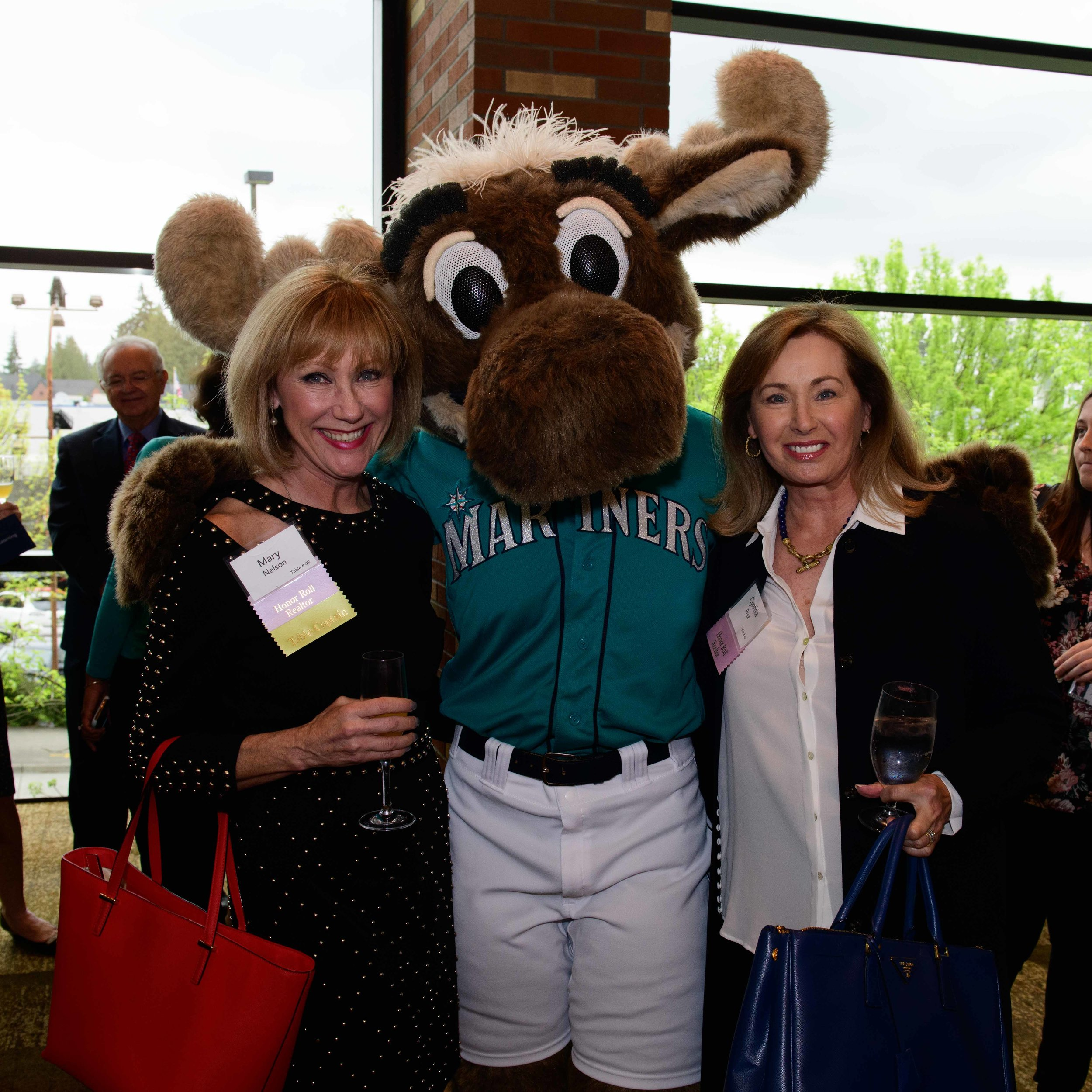 RSIR Broker Mary Nelson (left) and I were ecstatic to meet the Mariner Moose at the event!
