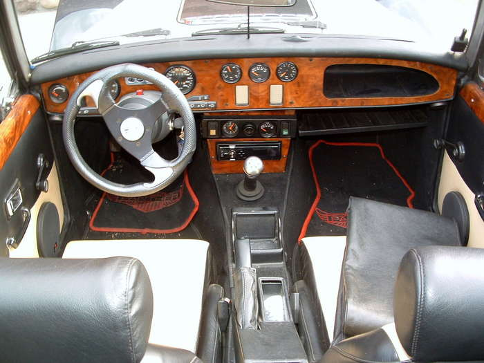 The interior isgoing to be alot different as well the shifter and ebrake will be further back and the seat with be much more comfortable with bolsters and custom made leather seats.