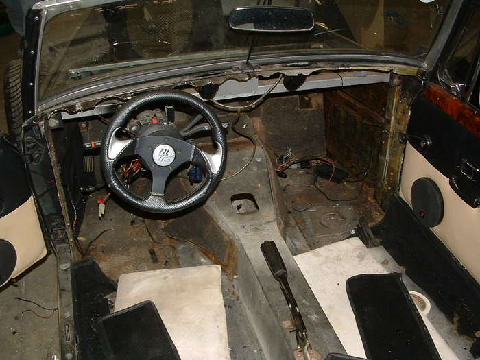 This shows the inside of the car you can see the old shifter hole this will be welded up and a new one made a few inches back