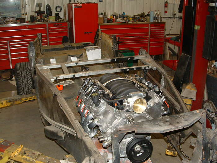 Here the firewall is removed and the new motor and transmission are mocked up.