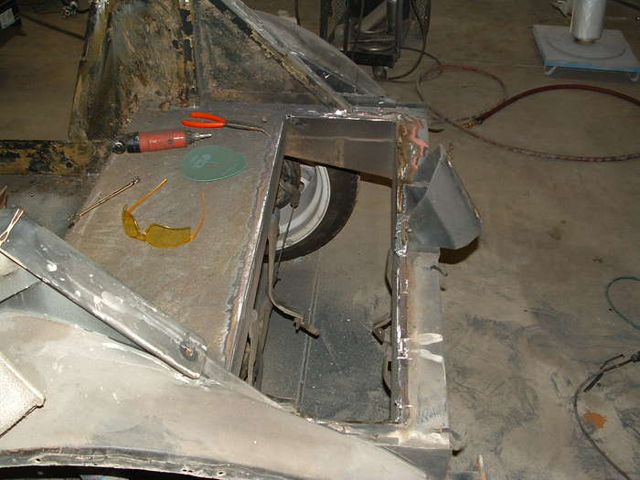 Here the old fuel tank cover has been cut out to make room for the new one. The new tank will be stainless steel and the fuel pump will be internal