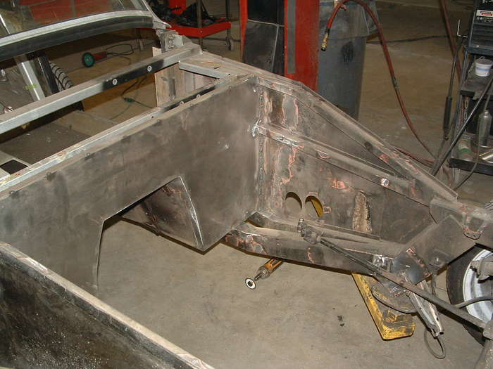 Here you see the firewall after it has been ground it looks much better than the original with out all the extra holes.
