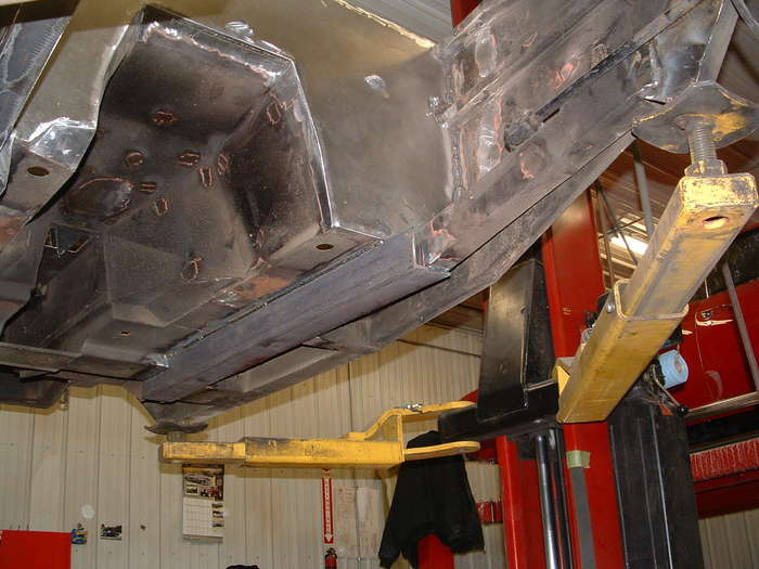 This shows the brackets that were removed under the car and the thicker frame rail being installed.