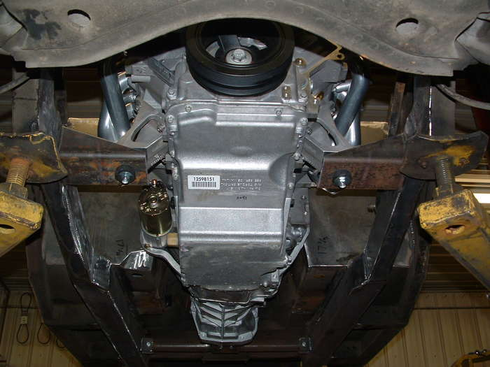 A good shot of the bottom that shows the motor mounts and frame rail modifications.