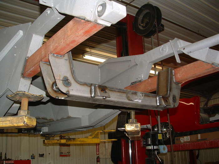 Here the new crossmember is installed with the rack and pinion mounts.