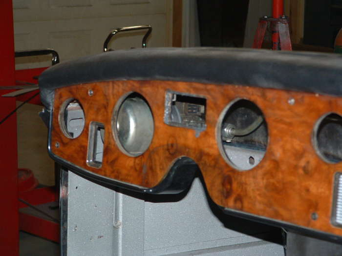 threw the old dash holes you can see the wiper motor in its new location.