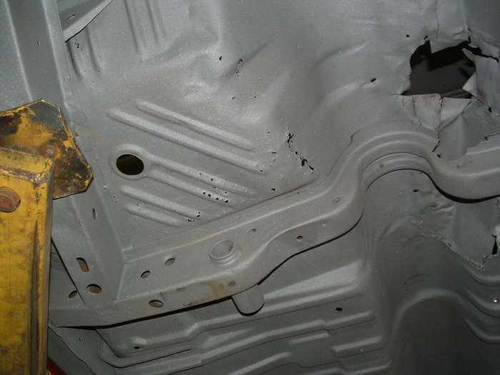 Some of the pin holes in the floor pan. The frame rails are really nice in this car that is hard to find these days usually we have to replace them to.