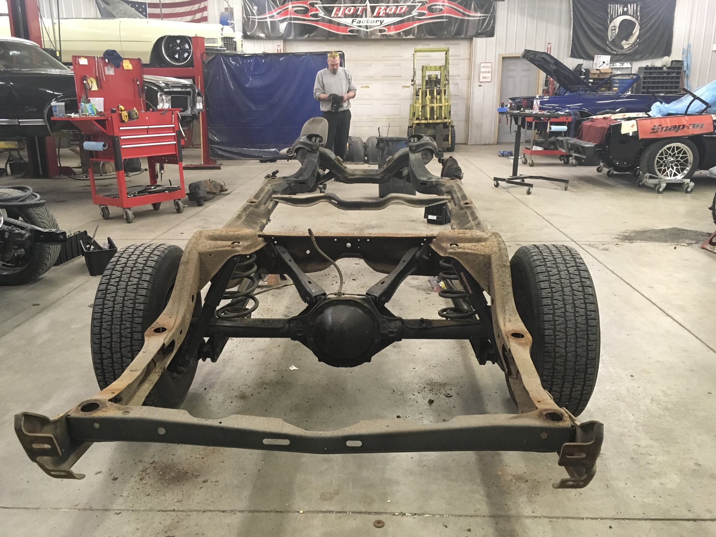 Frame removed from car, 1970 Oldsmobile Cutlass.
