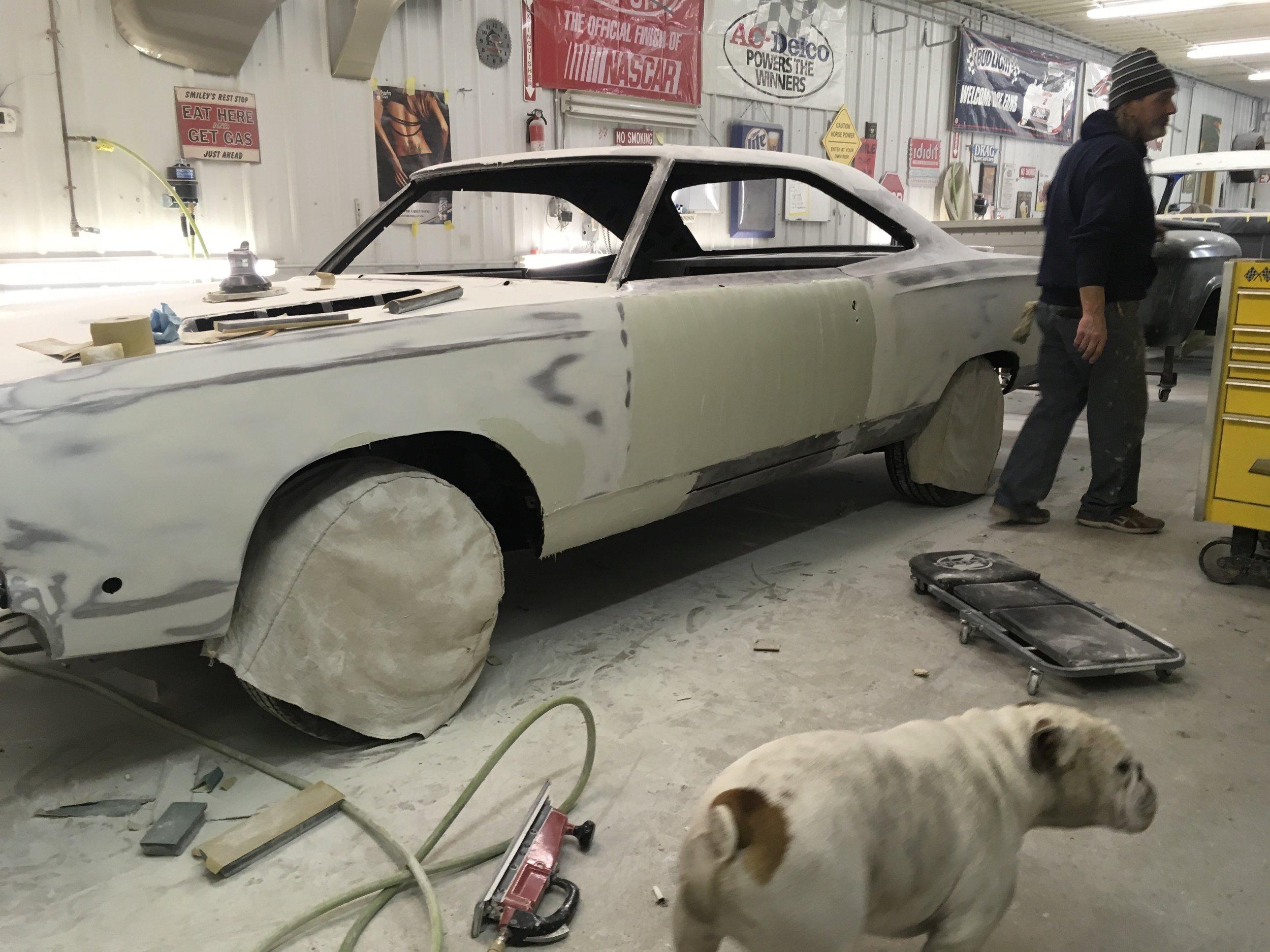 Finishing mud work on 68 Plymouth GTX.