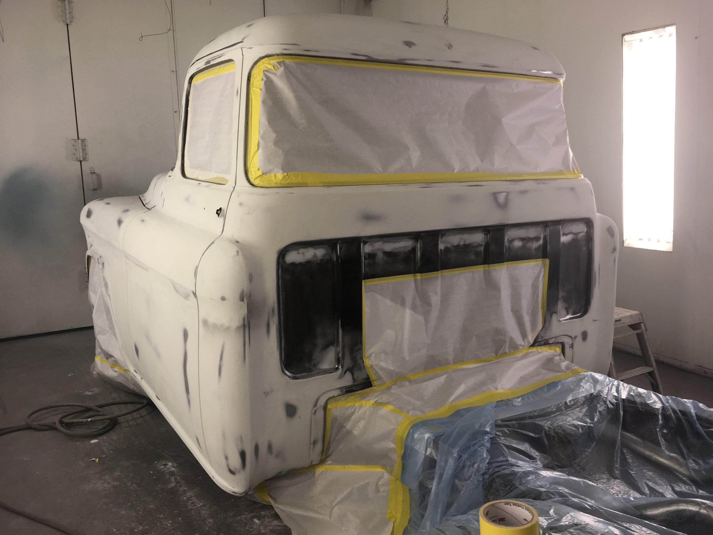 GMC truck, taped and ready for primer